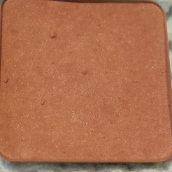 This is Rockateur Blush from Benefit Cosmetics. It's the size that came in a value set so I've depotted it from the set. It has some hard spots throughout so it's time I use it up. I will probably repurchase the a full or mini size once it's gone because it works with every makeup look.