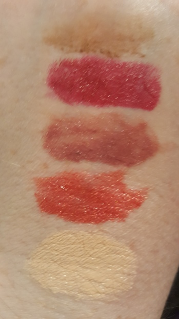 Swatches of ColorStay Brow Mousse Soft Brown; Super Lustrous Lipstick Bombshell Red; Ultra HD Matte LipColor Metallic 680 HD Glam; Metallic Matte LipColor 700 HD Flare; PhotoReady Insta-Filter Foundation 130 Porcelain